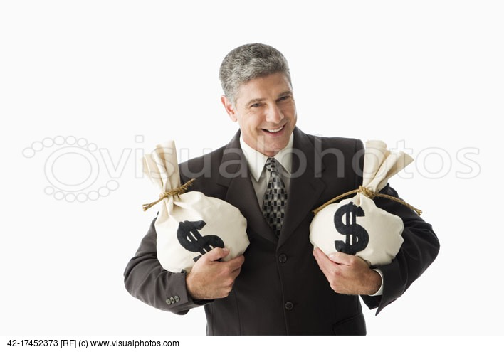 Image: Smiling businessman holding money bags